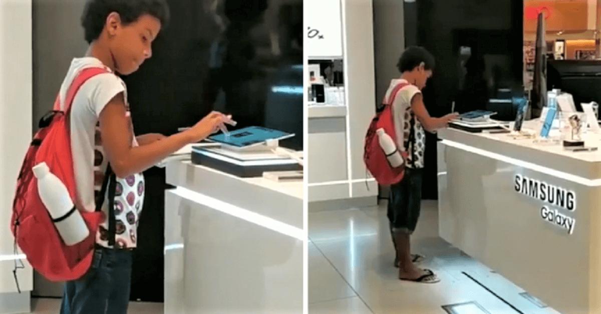 Guilherme pesquisando no tablet - Menino filmado estudando em um tablete de uma loja, ganha o aparelho da Samsung