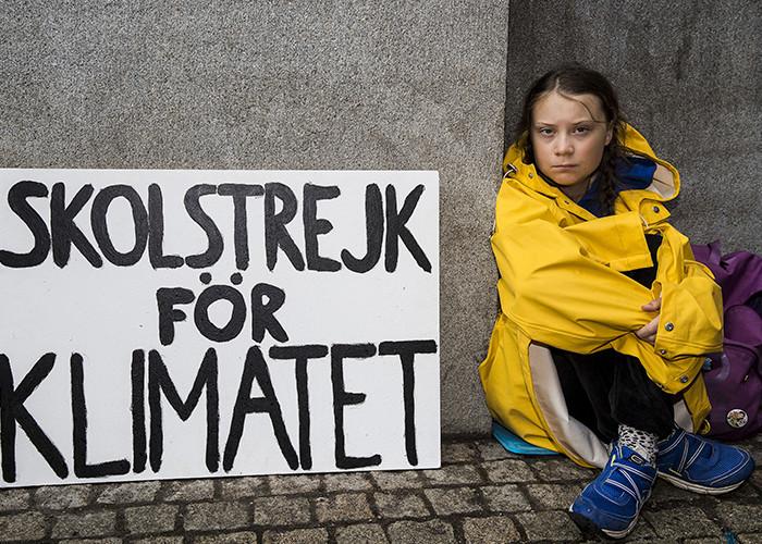 """Greta em protesto contra o aquecimento global Getty Images - Greta Thunberg, a ambientalista, é eleita """"pessoa do ano"""" pela revista Time"""